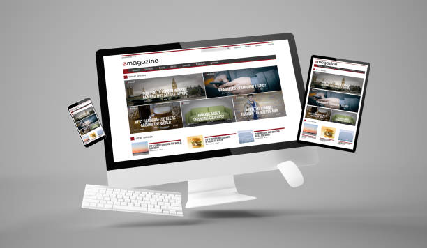 computer, tablet and smartphone gravity showing e-magazine responsive website stock photo