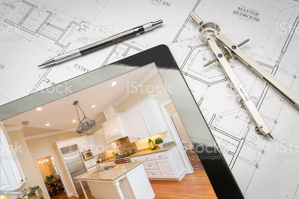 Computer tablet showing finished kitchen on house plans for House plans with finished photos