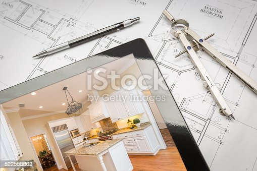 istock Computer Tablet Showing Finished Kitchen On House Plans, Pencil, 522558862