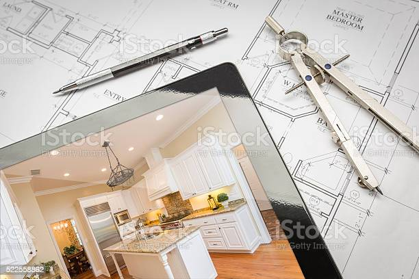Computer tablet showing finished kitchen on house plans pencil picture id522558862?b=1&k=6&m=522558862&s=612x612&h=06rxuhrd0kn4mxlspifsexai4drwmv5oh c1txbtuaa=