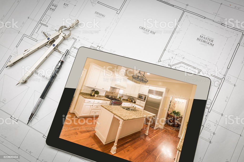 Computer Tablet Showing Finished Kitchen On House Plans, Pencil, stock photo