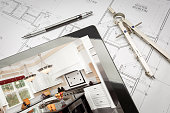 istock Computer Tablet Showing Kitchen Illustration On House Plans, Pencil, Compass 1210633276