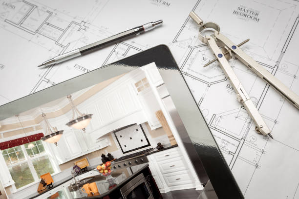 Computer Tablet Showing Kitchen Illustration On House Plans, Pencil, Compass stock photo
