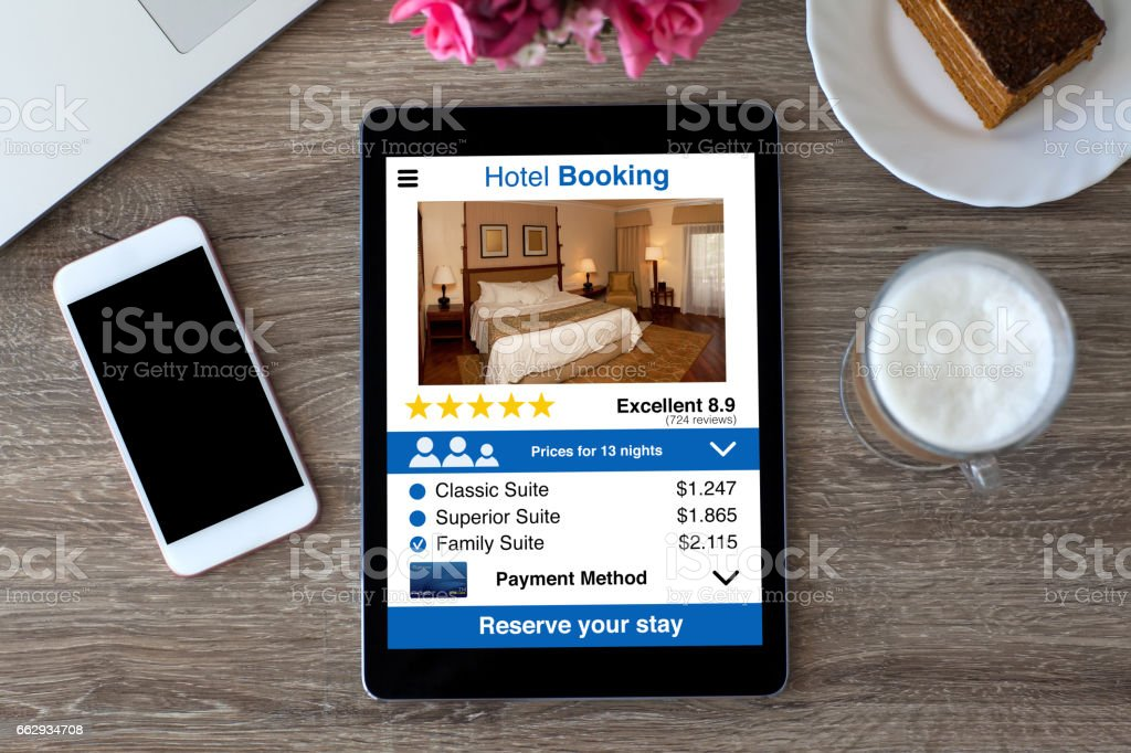 computer tablet with app hotel booking and touch phone table stock photo