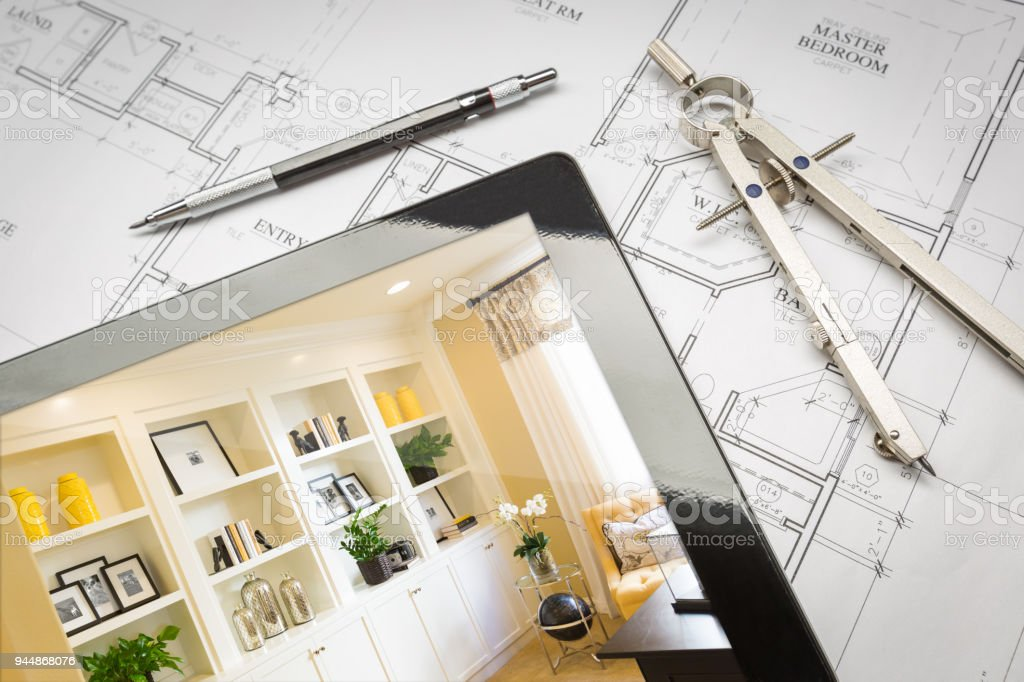 Computer Tablet with Finished Built-in Shelves and Cabinets Over House Plans, Pencil and Compass. stock photo