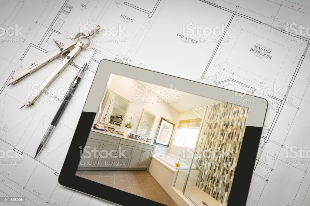 Computer Tablet with Master Bathroom Design Over House Plans, Pencil and Compass. royalty-free stock photo
