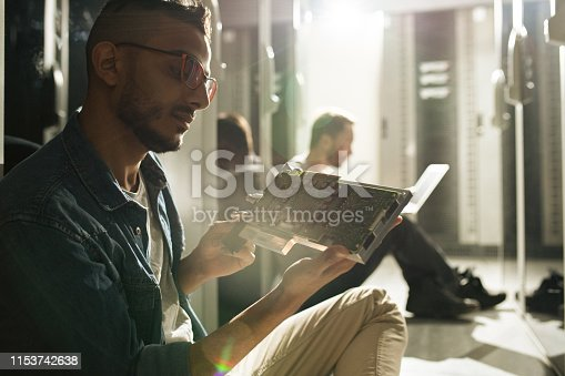 istock Computer technician analyzing connectors of circuit board 1153742638
