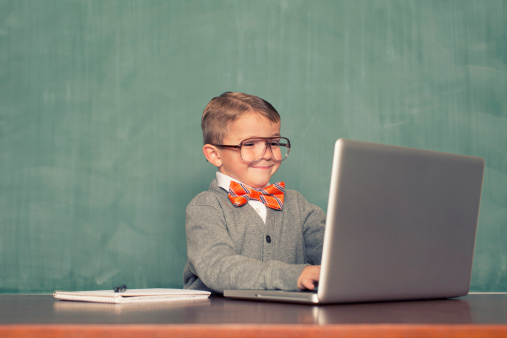 A young nerd is updating his blog.