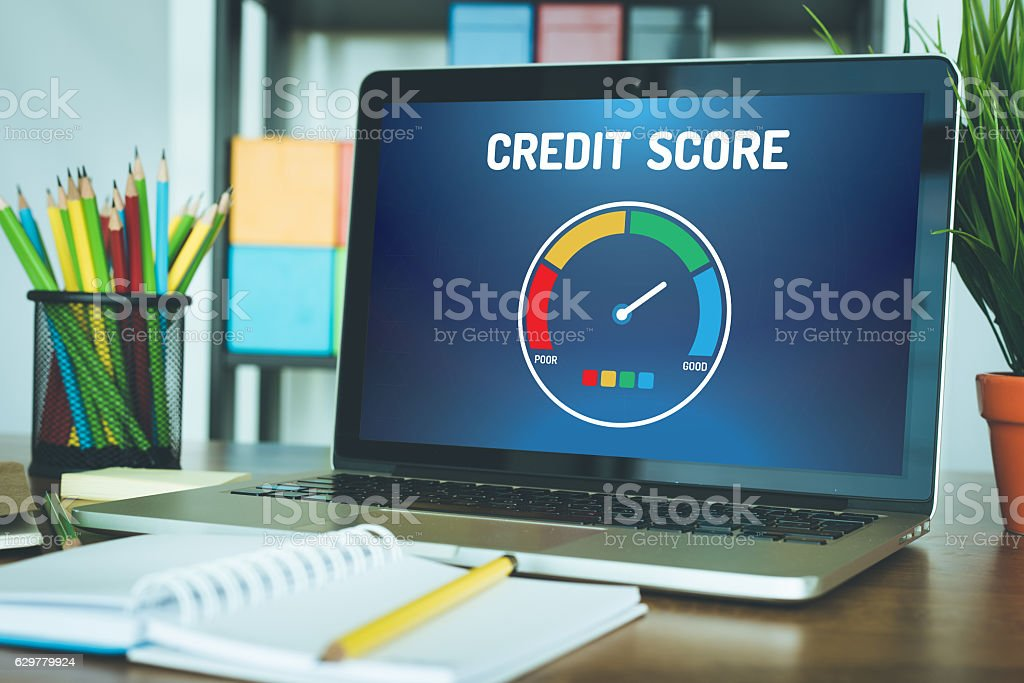 Computer with credit score application on a screen stock photo