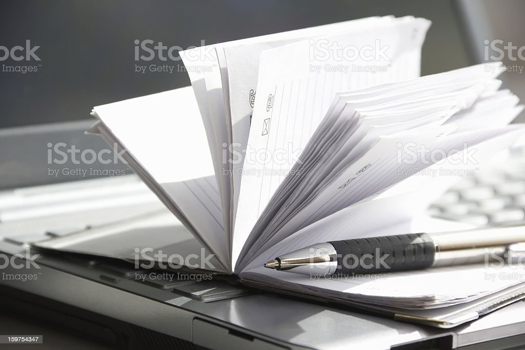 computer with notebook and a pen royalty-free stock photo