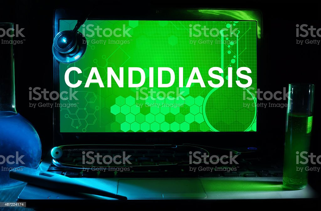 Computer with words Candidiasis (Moniliasis, Thrush). Medical concept. stock photo