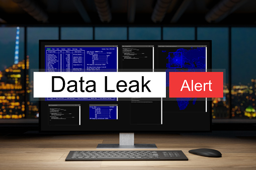istock computer workstation in dark night office with skyline view warning data leak, 3D Illustration 1263543416