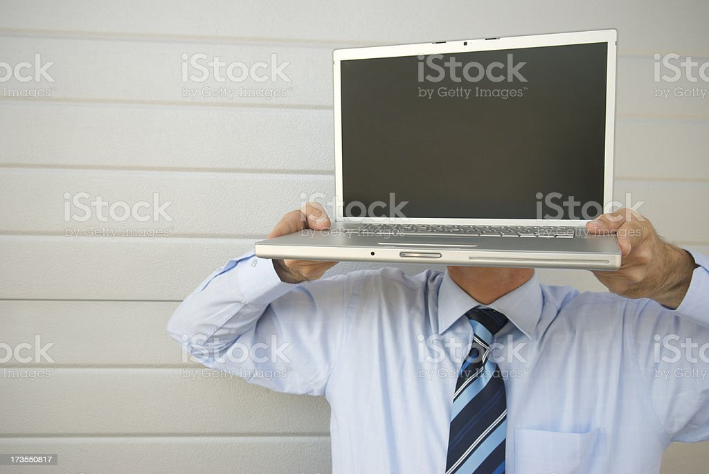Computerhead Businessman Stands by Wall royalty-free stock photo