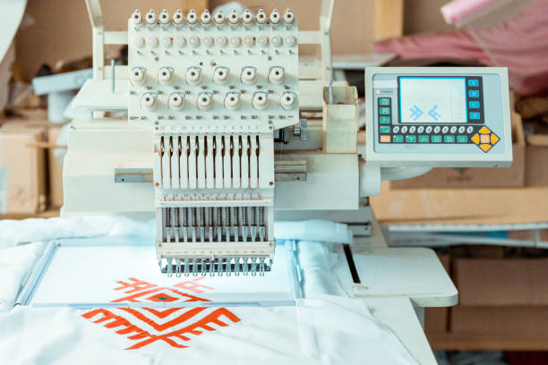 computerized embroidery machine - embroidery machine stock pictures, royalty-free photos & images
