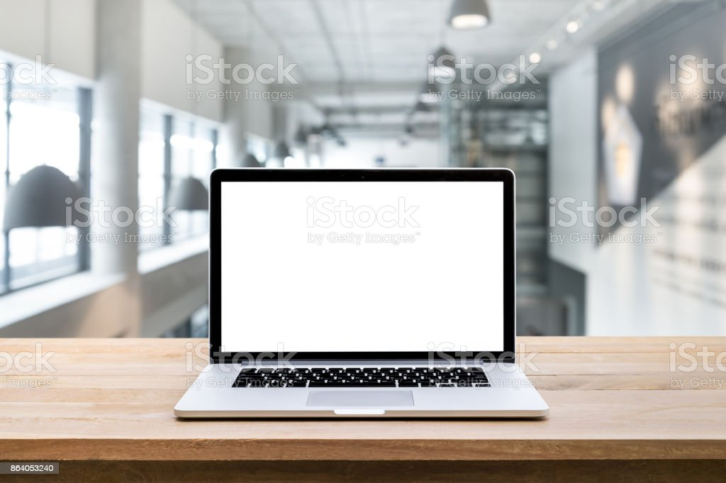 Computer,laptop with blank screen on blur modern/contemporary hall backgrounds stock photo