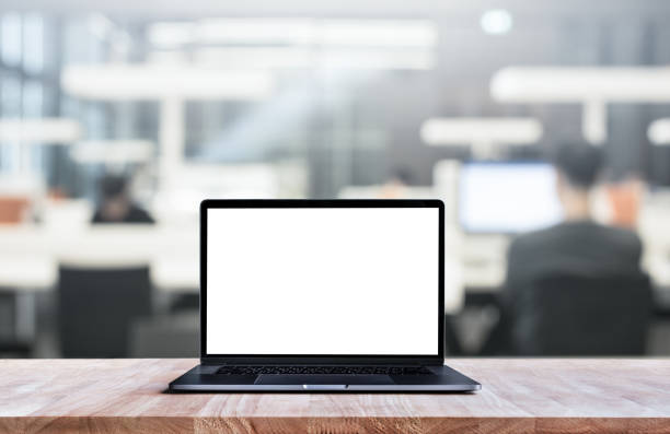 Computer,laptop with blank screen on blur working space stock photo