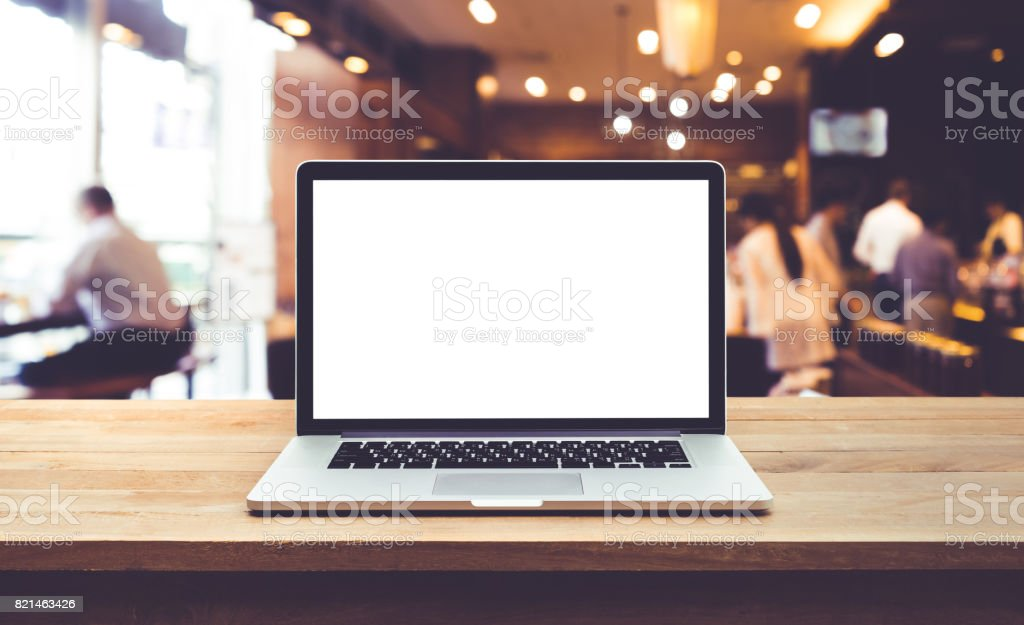 Computer,laptop with blank screen on table cafe,restaurant