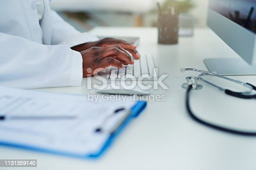 Cropped shot of a female doctor working on her computer