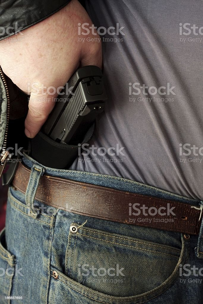 Concealed Carry Firearm Drawn From an Inside-the-Waistband Holster royalty-free stock photo