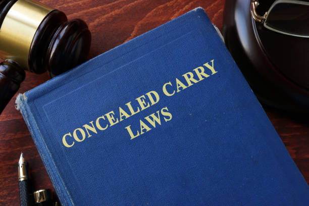 Concealed Carry Laws title on a book and gavel. stock photo