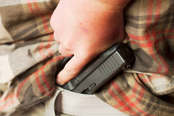 Concealed Firearm Drawn From Waistband stock photo