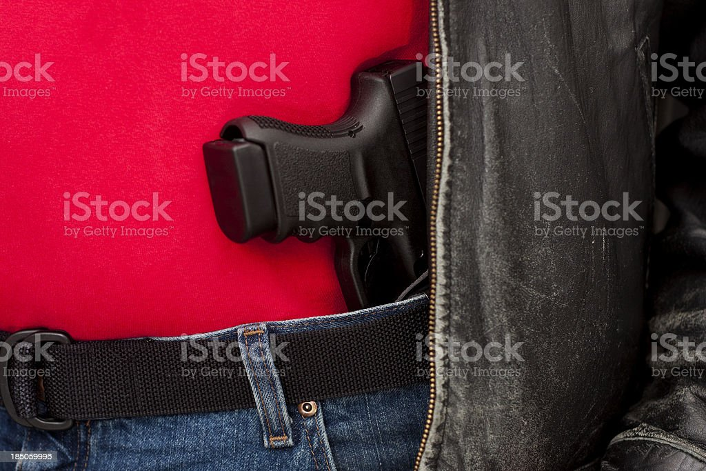 Concealed Firearm Under Jacket royalty-free stock photo