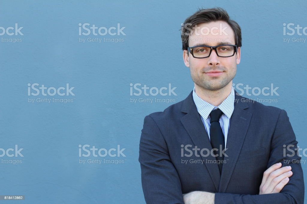 Conceited elegant businessman with arms crossed stock photo