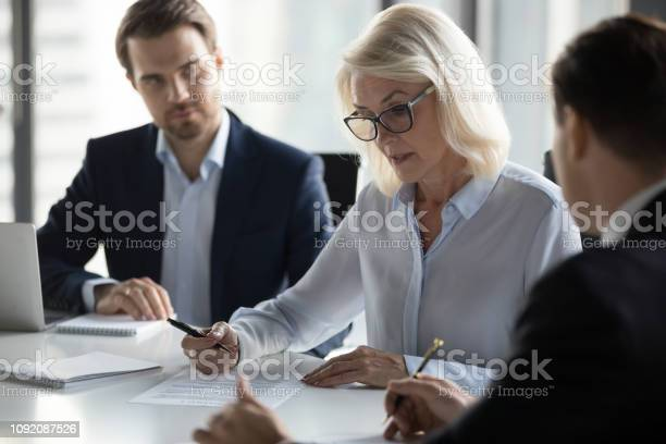 Concentrated aged businesswoman checking agreement before signing picture id1092087526?b=1&k=6&m=1092087526&s=612x612&h=1irzquk9791dxjm0kzly08xrgs2z22komvxz1inikbm=