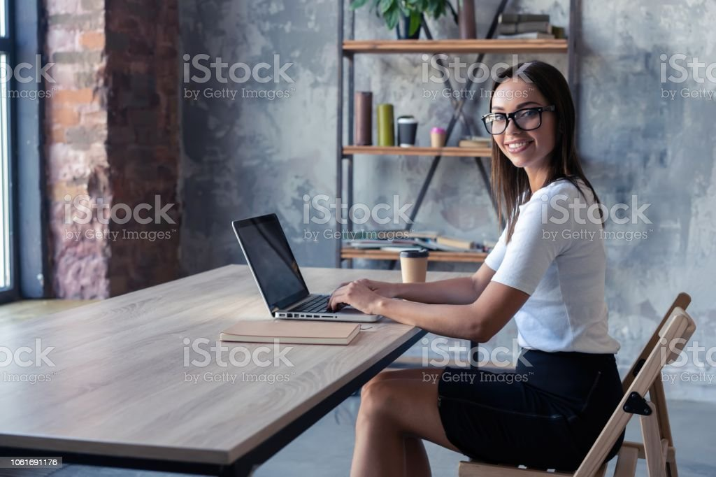 Concentrated at work. Confident young woman in smart casual wear...
