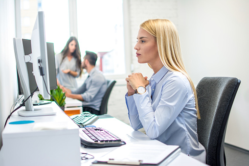 Concentrated Business Woman In Front Of Computer In Office Stock Photo - Download Image Now