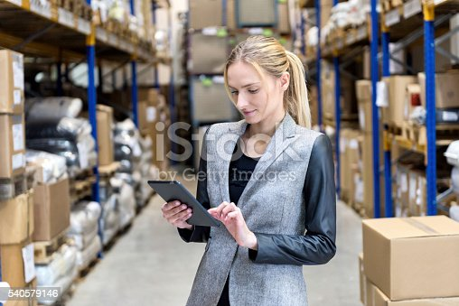 istock Concentrated business woman searching on tablet 540579146