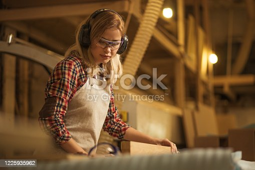 istock concentrated confident carpenter deals with piece of wood 1225935962