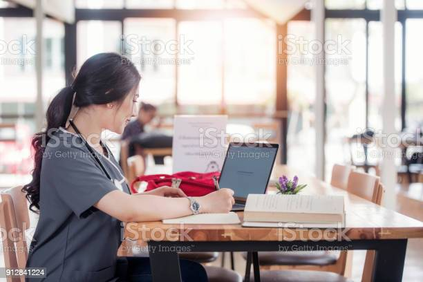 Concentrated doctor or nurse working on line with a laptop sitting in picture id912841224?b=1&k=6&m=912841224&s=612x612&h=cc0cbprs0xc 8zqvy0ed2pckj6mt8tf5cpvskrywr9u=