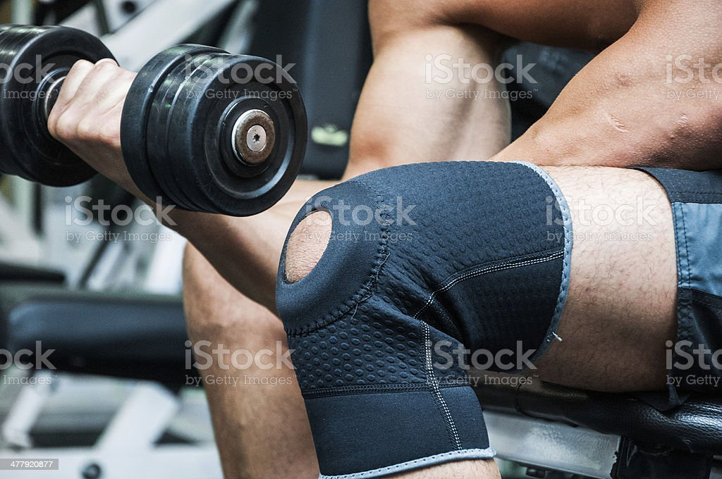 Concentrated dumbbell biceps curls stock photo