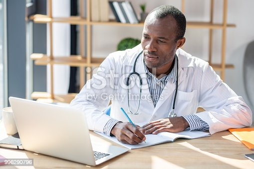 istock Concentrated foreigner preparing his scientific work 996290796