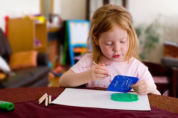 Concentrated girl, drawing stock photo