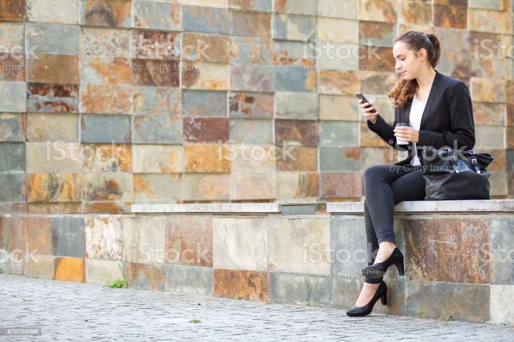Concentrated lady using social media on smartphone stock photo