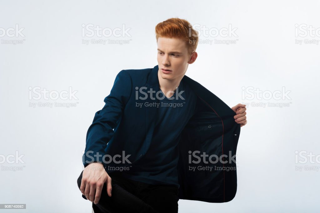 Concentrated man looking in the distance stock photo