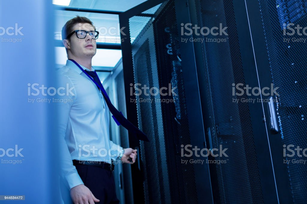 Concentrated man opening the door stock photo