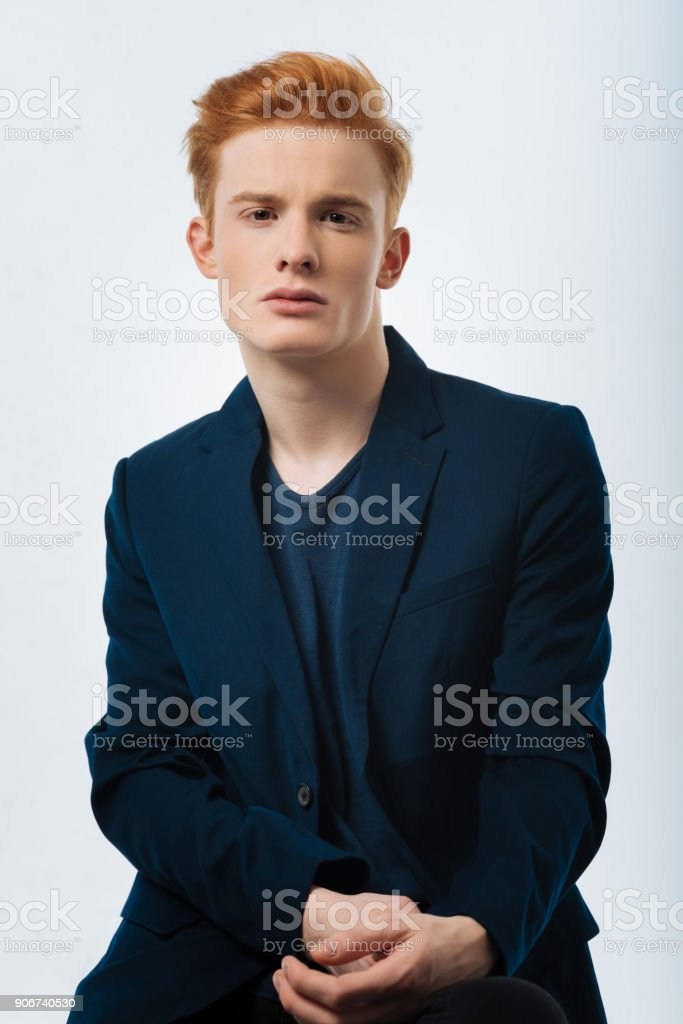 Concentrated man wearing a black jacket stock photo