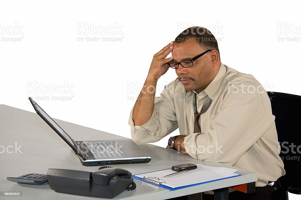 concentrated mature businessman sitting at laptop royalty-free stock photo