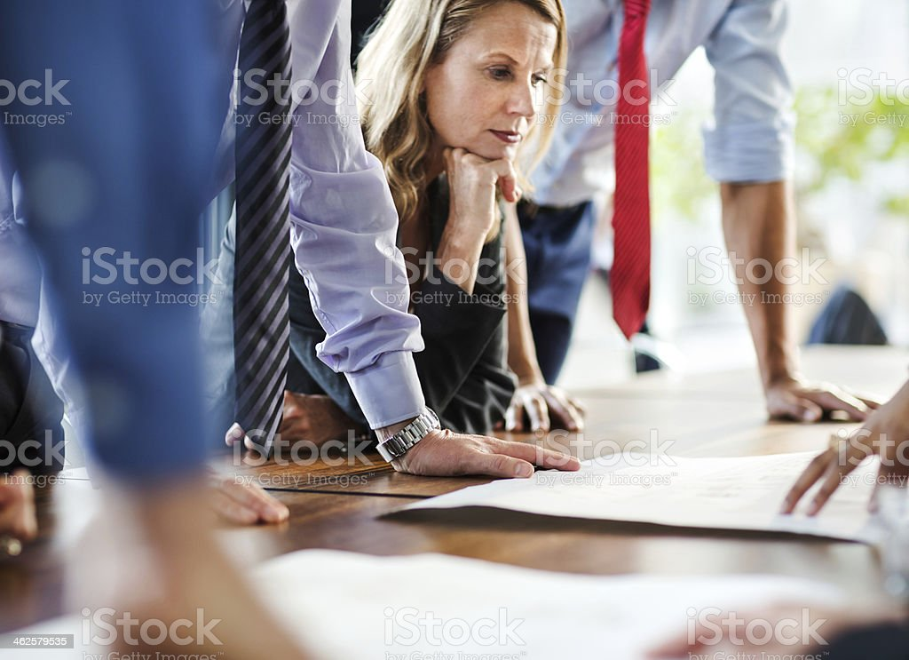 Concentrated Mature Businesswoman During Meeting stock photo