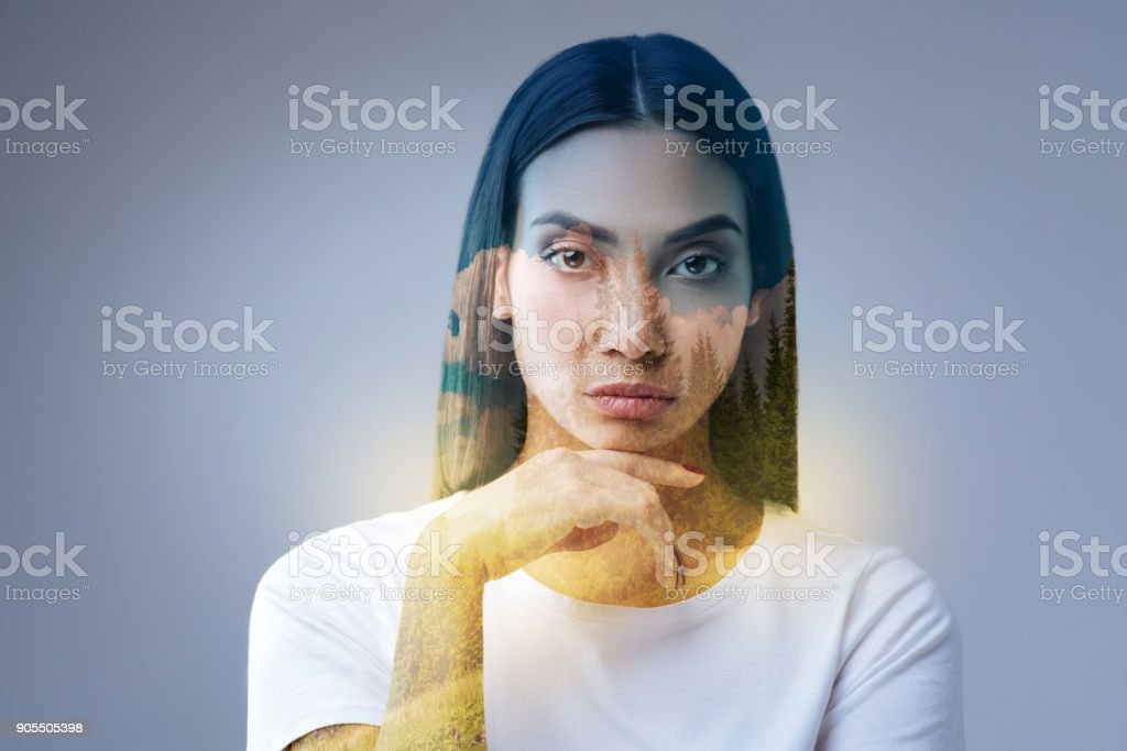 Concentrated meditative  woman evaluating new prospectives stock photo