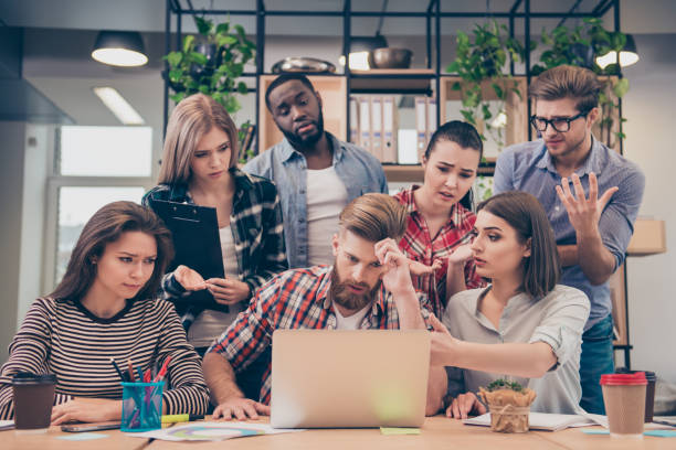 Concentrated multinational business team working hard together stock photo