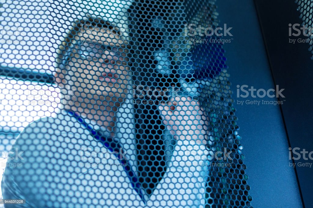 Concentrated operator working in a data center stock photo