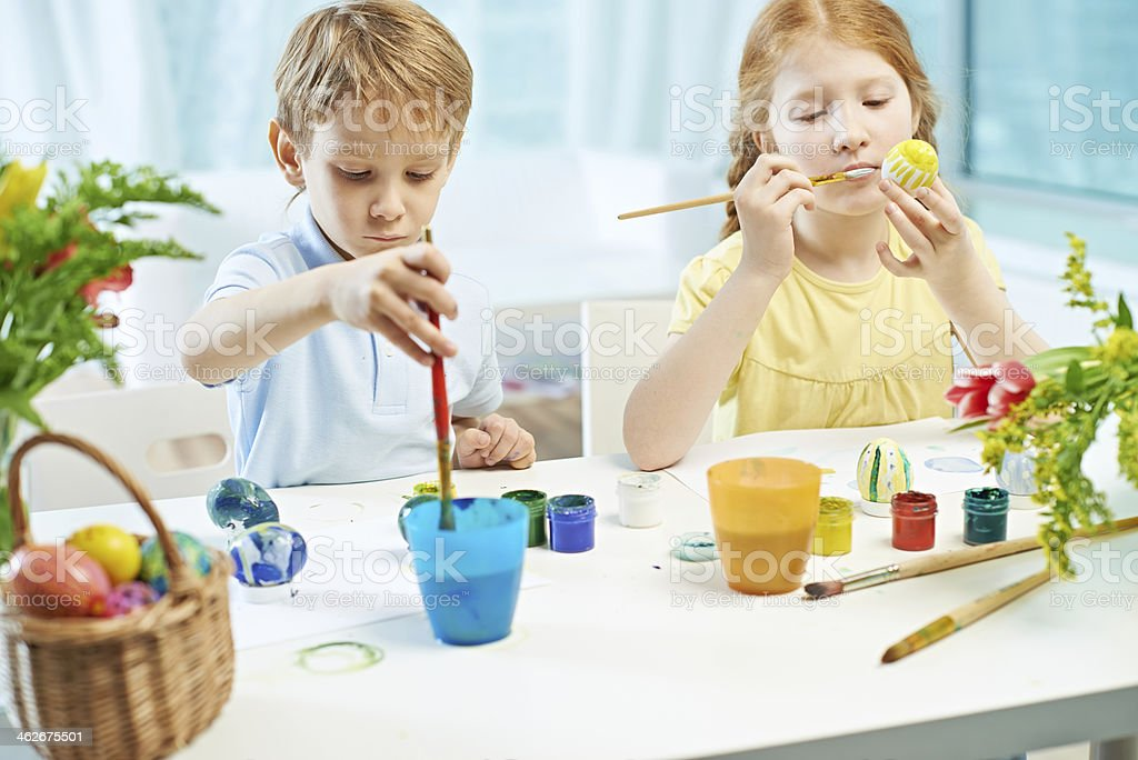 Concentrated painters royalty-free stock photo