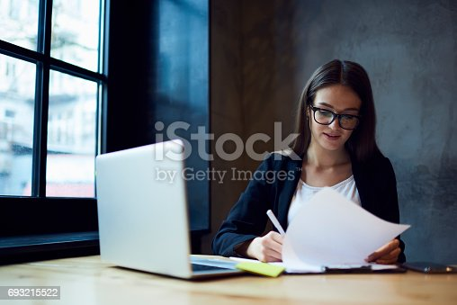 istock Concentrated professional female administrative manager working 693215522