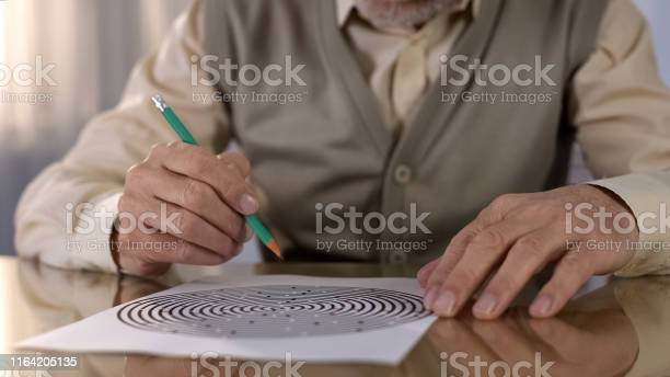 Concentrated retired man solving logic test at table memory exercise picture id1164205135?b=1&k=6&m=1164205135&s=612x612&h=jv2tnnpt21dtdmuskpblboqajx2 gw7dvsgszhhev0a=