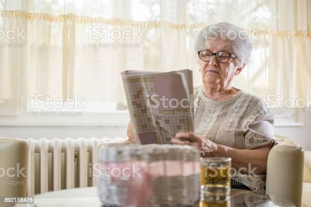 Concentrated senior woman doing some crossword at home picture id892118476?b=1&k=6&m=892118476&s=612x612&h=ytsgpimm0skbmz3tsw3ys2gzeypke2vxqcqjajj5utk=
