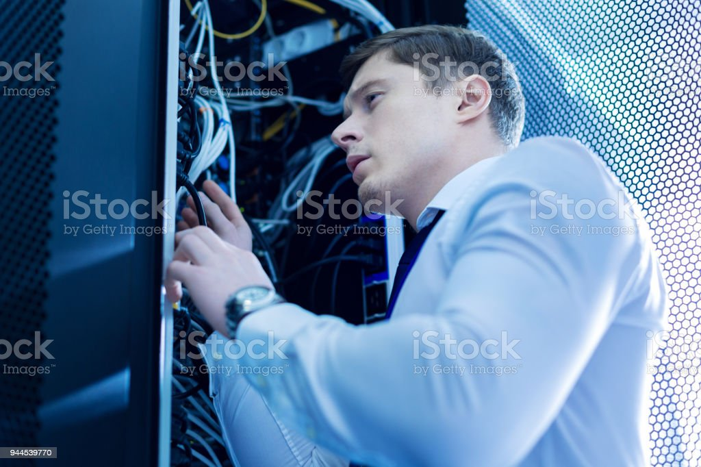 Concentrated skillful operator repairing wires stock photo